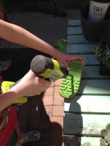Drill a hole in the ribber rain boot sole